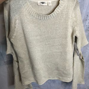 Grey sweater with cut outs at the elbow
